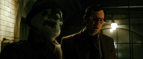Dan Dreiberg se reune con Rorschach y se pregutan ¿para quién trabajaba Eddie?